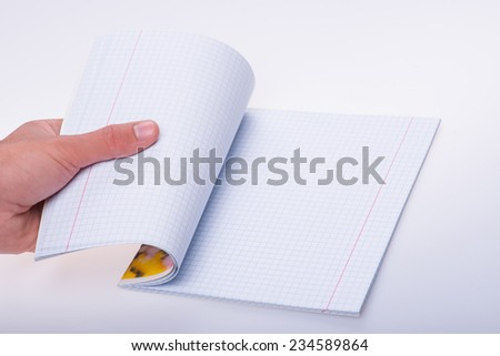 Hands of the man opening new empty notebook beginning new life isolated on white background - stock photo