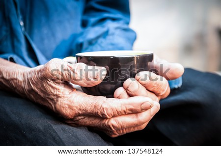 hands of the old man - stock photo