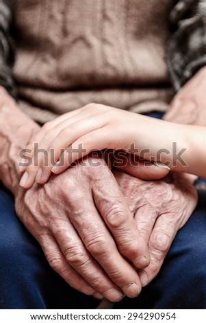 Hands of the old man and a young woman.. toning