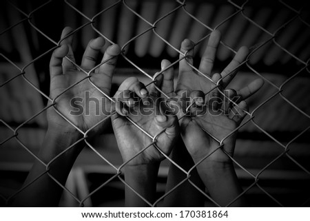 Hands of the prisoner - stock photo