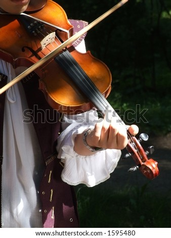 Hands of the violinist - stock photo