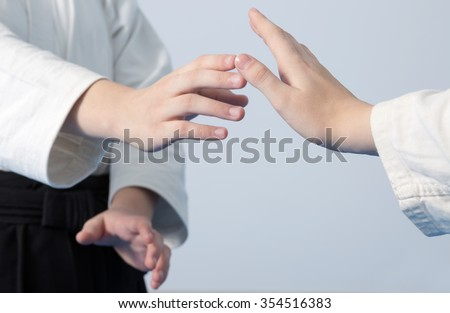 Hands of two girls standing in a stance on martial arts training