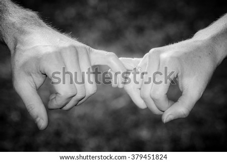 Hands of Two Lover's Held by a Pinky Fingers, Pinky Swear - stock photo