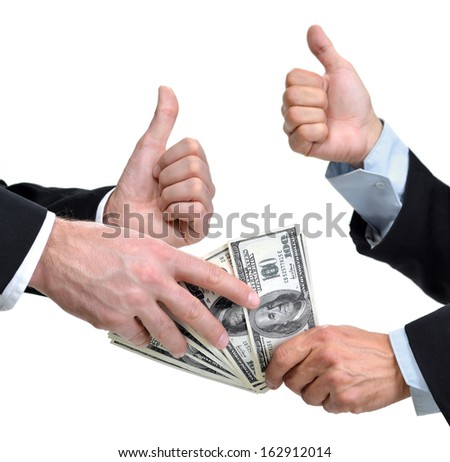 Hands of two men giving and taking dollars - stock photo