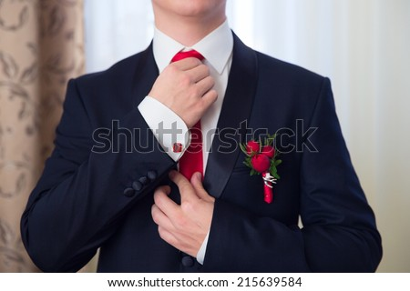 Hands of wedding groom getting ready in suit.  - stock photo