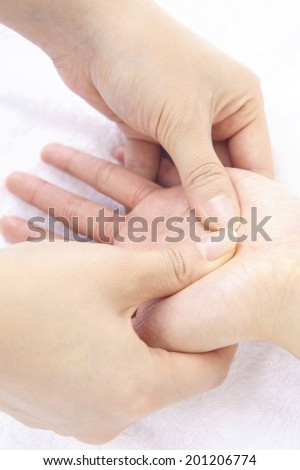 Hands of woman getting a massage