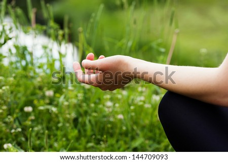 Hands of woman meditating