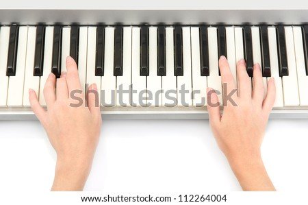 hands of woman playing piano - stock photo