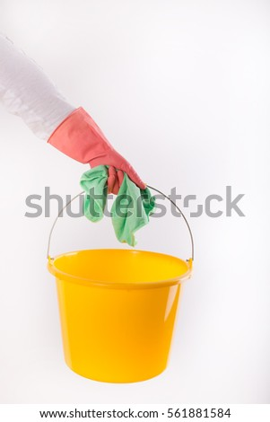 Hands of woman with rubber gloves holding bucket with cloth, isolated on white background