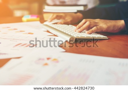 Hands of woman woman typing and working at office. - stock photo