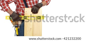 Hands of worker with wooden plank and ruler.