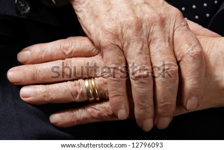 Hands of 103 years old man with two wedding rings - stock photo
