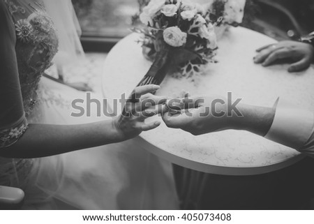 Hands of young wedding couple