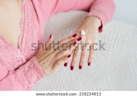 Hands of young woman with cream, skincare