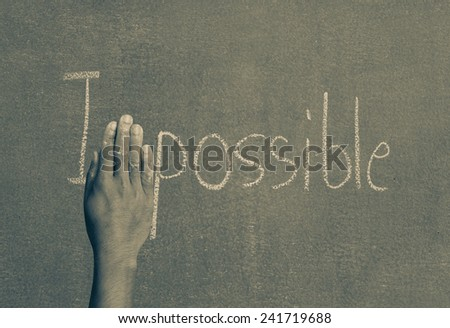 Hands off the impossible letter M on board. - stock photo