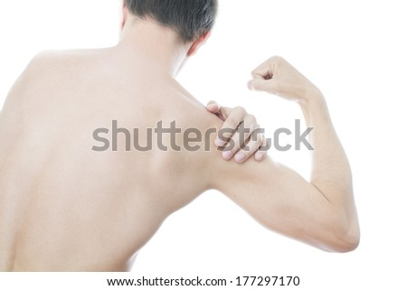 Hands on a men's shoulder. Pain in the muscles. - stock photo