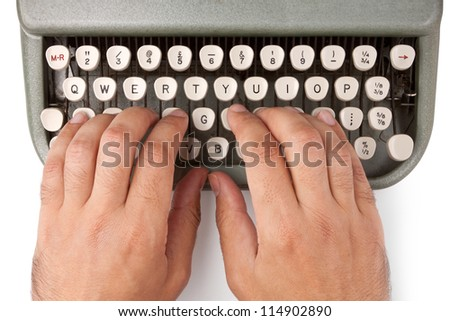 Hands on a typewriter keyboard on a white background - stock photo