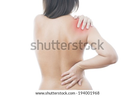 Hands on a woman's shoulder. Pain in the muscles. - stock photo