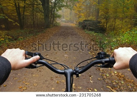 hands on bicycle, first person view - stock photo