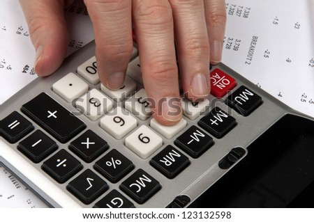 Hands on calculator  with  financial papers - stock photo