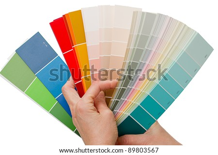 Hands on choosing color swatches. Color chart book. Isolated on white background - stock photo