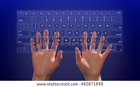 hands on computer keyboard. touch screen interface