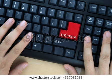 "Hands on computer keyboard with ""Solution"" word at enter button. - stock photo"