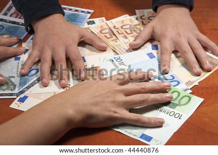 hands on euro banknotes - stock photo