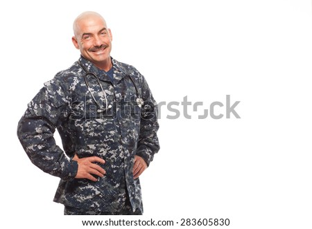 Hands on hip and copy space; Navy doctor, corpsman or chief grinning on white background. - stock photo