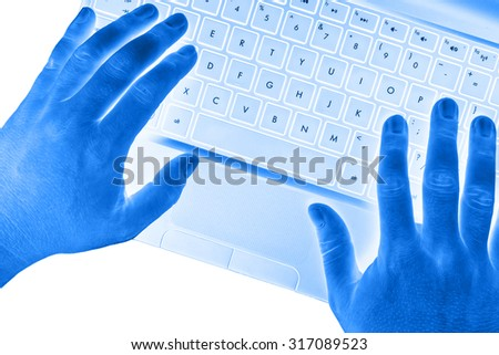 Hands on laptop with blank spacebar button on white background.
