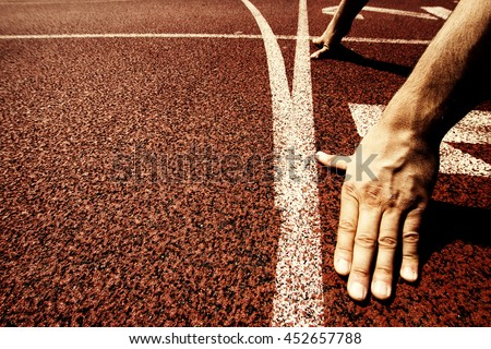 Hands on starting line