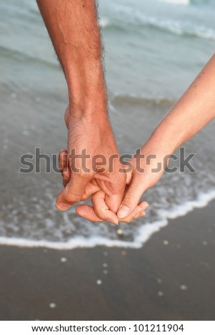 hands on the beach. on a nice day