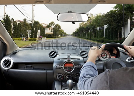 Hands on the steering wheel, arriving at home
