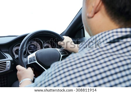 hands on the steering wheel with isolated window - stock photo