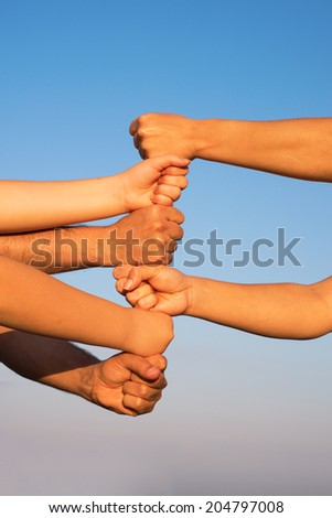 Hands on top of each other - stock photo