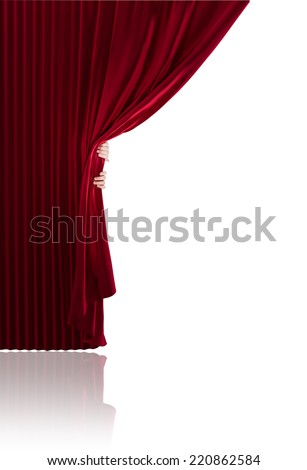 Hands opening a realistic stage curtains on a white background. - stock photo