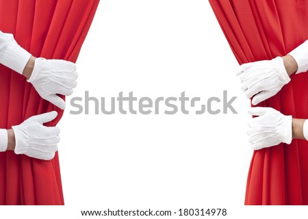 hands opening red curtain on white. - stock photo