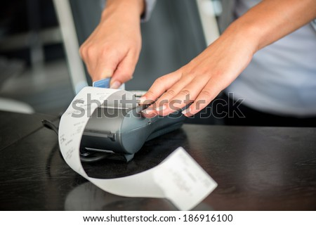 Hands operating pos terminal with magnetic card - stock photo