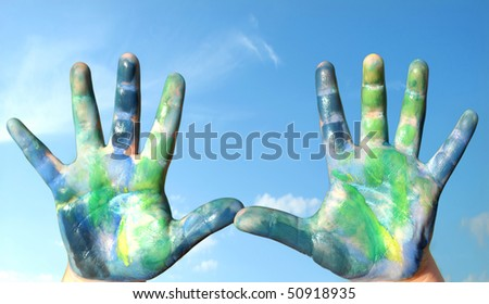 hands paint in colors as our planet, green and blue - stock photo