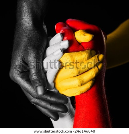 hands painted in different colors. multiracial concept. every color represent one skin race - stock photo