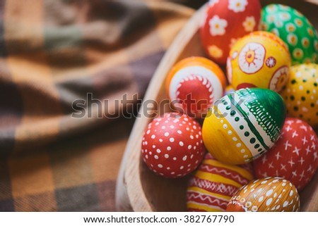 Hands painting Easter eggs  - stock photo