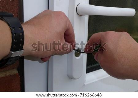 hands picking a door lock & Lock-picking Stock Images Royalty-Free Images u0026 Vectors ... pezcame.com
