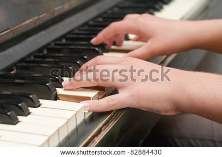 hands playing music on the piano, hands and piano player, keyboard - stock photo