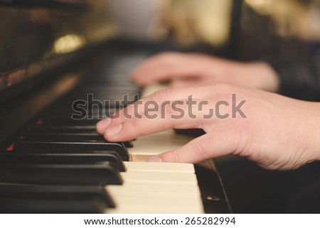 Hands playing the piano (close-up) with oldschool vintage instagram filter - stock photo