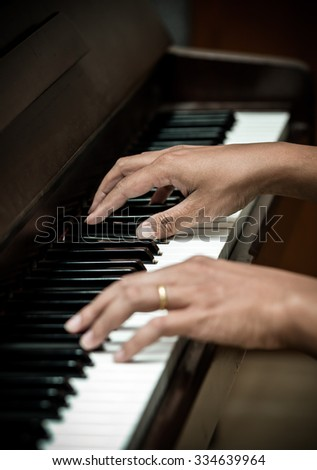 hands playing the piano,musical instrument - stock photo