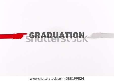 Hands pointing GRADUATION word - stock photo