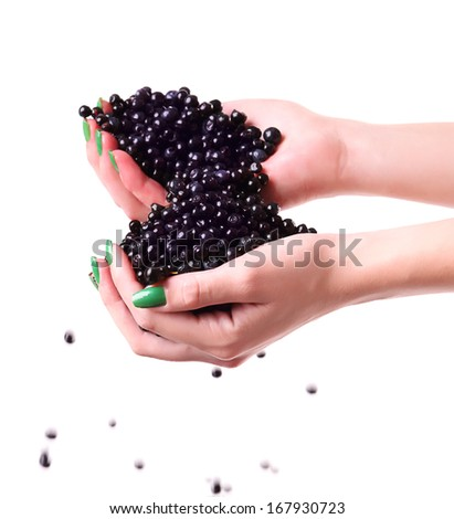 Hands pouring fresh blueberries