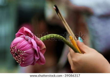 hands praying holding lotus and incense, bagkok thailand - stock photo
