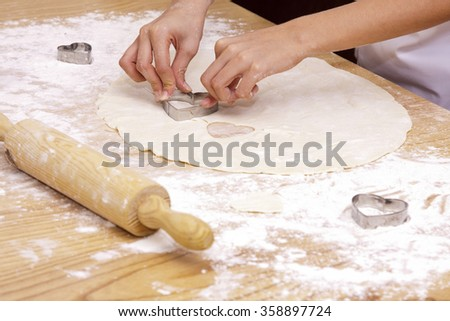 hands preparing cookies with dough
