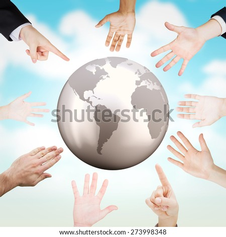 Hands presenting against blue sky - stock photo